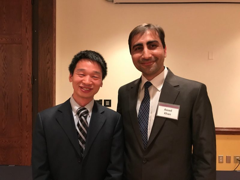 Assistant Professor Greg Lui and Graduate student of the year Assad Khan in business suits at the awards banquet