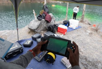 Dye tracking research at the quarry pond. Photo credit Peter Means