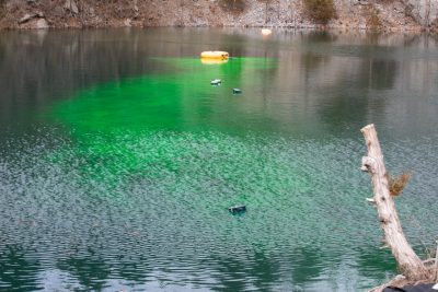 Dye tracking experiment at the quarry pond. Photo credit: Peter Means