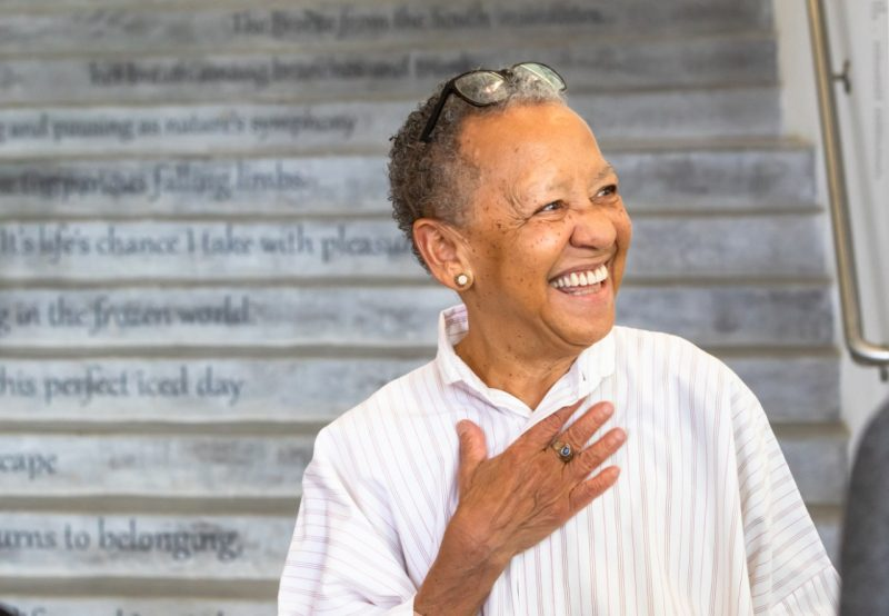 Nikki Giovanni stands in front of the poetry steps at the Moss Arts Center.