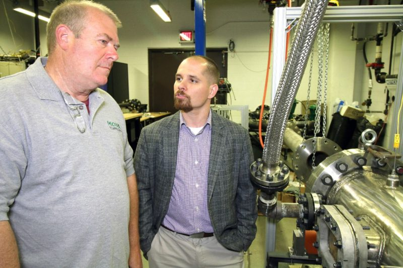 Steve Critchfield, CEO and President of MOVA Technologies, meets with Joseph Meadows, assistant professor of mechanical engineering
