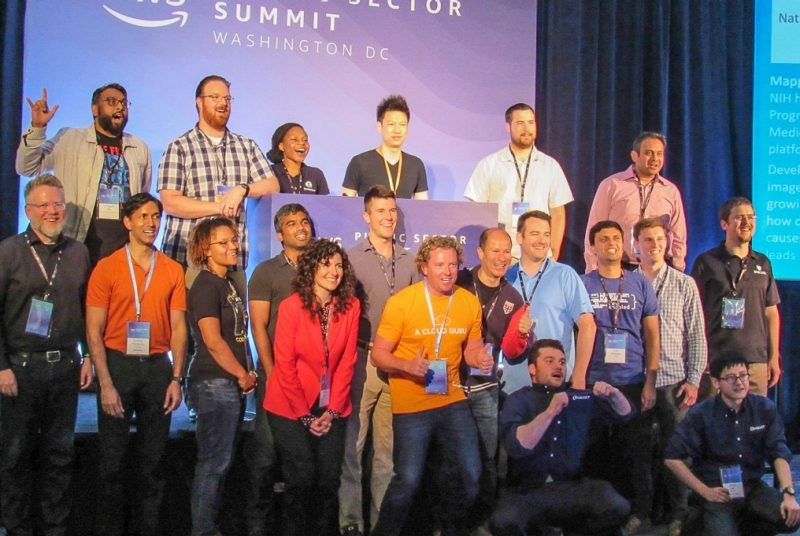hackathon winners and judges gather on state to celebrate