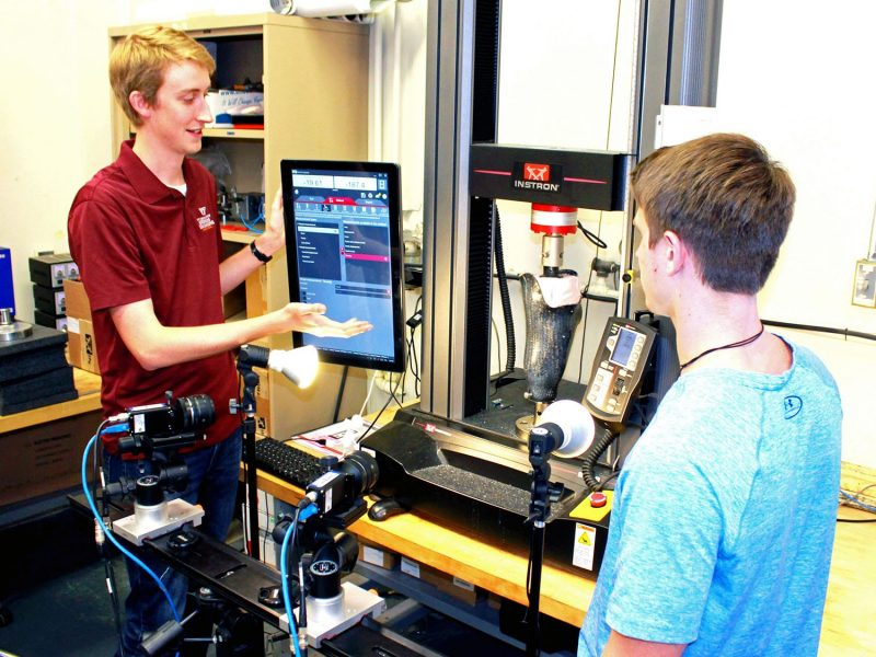 Carson Squibb and Trevor LeMaster track strains during simulated loading in the Aerospace Structures and Materials Laboratory.