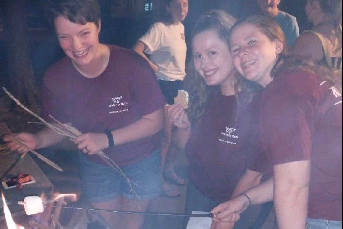 Hokie Connect mentors roast marshmallows.