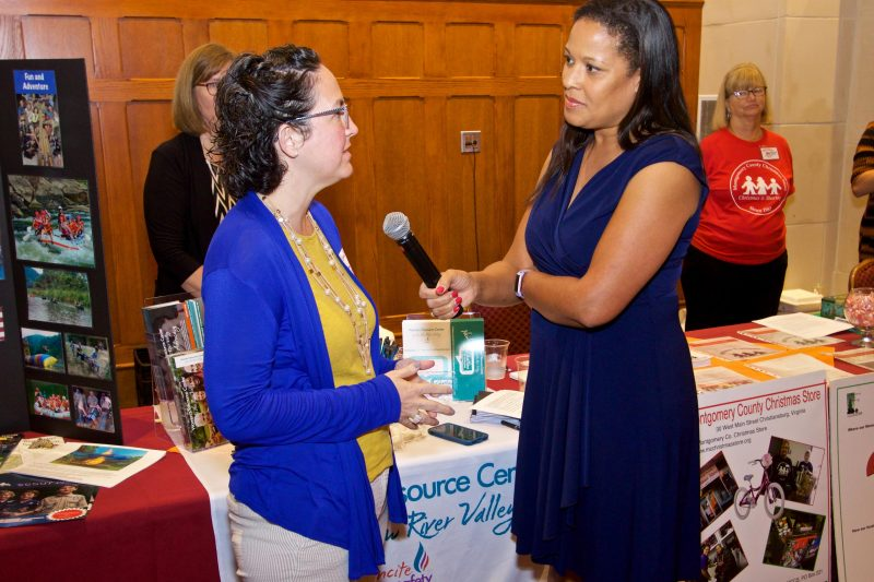 Photo of Dawn Jefferies interviewing Laura Beth Weaver, assistant director of the Women's Resource Center, at the 2019 CVC kickoff.