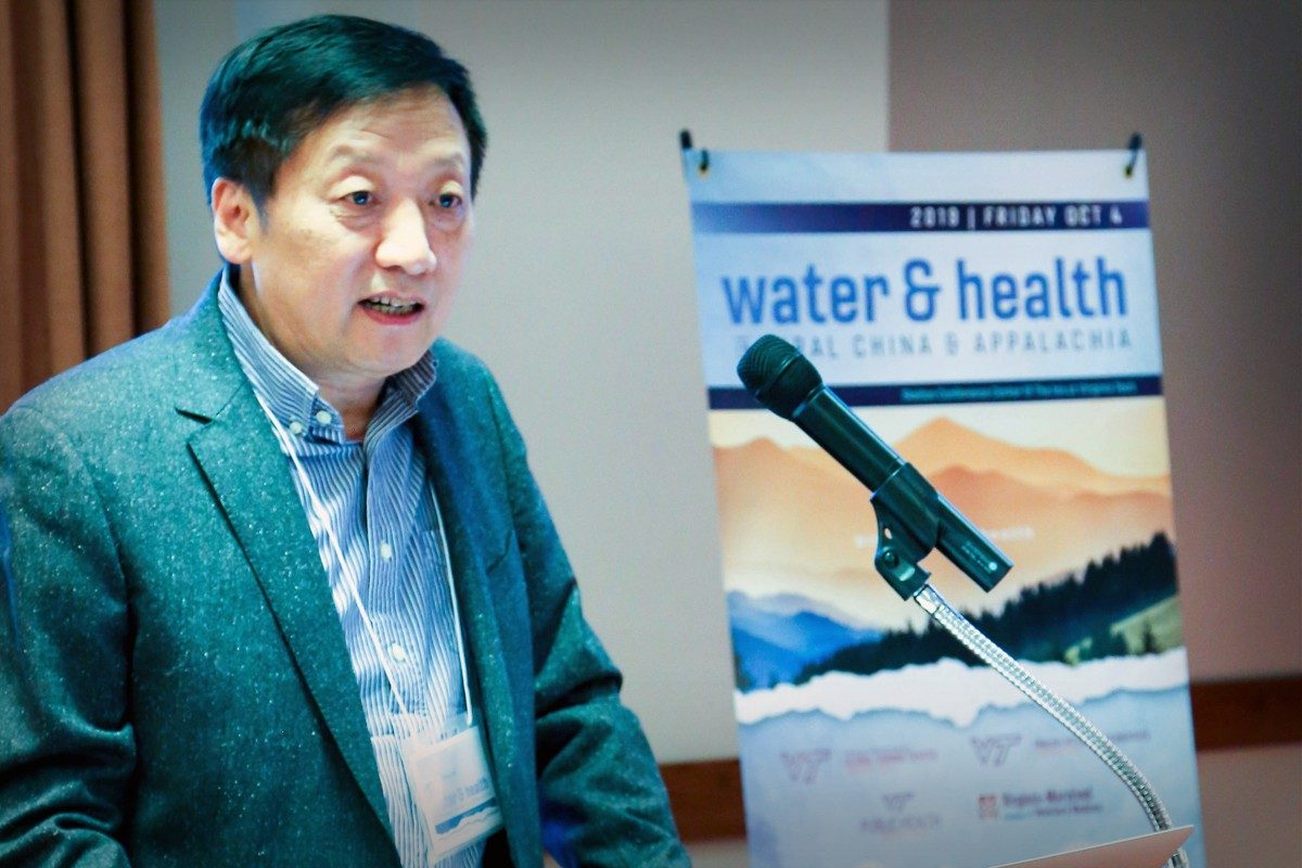 Tao Yong presenting at the Water and Health Conference