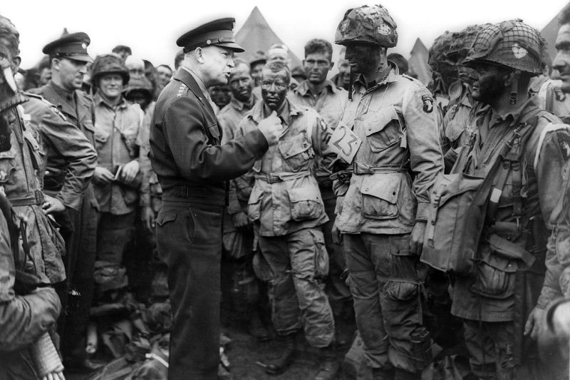 "At the Greenham Common Airfield in England, in advance of D-day in 1944, Gen. Dwight D. Eisenhower gives the order ""Full victory; nothing less"" to members of the 101st Airborne Division. The general also talked about fly fishing with his men, as he always did before a stressful operation."
