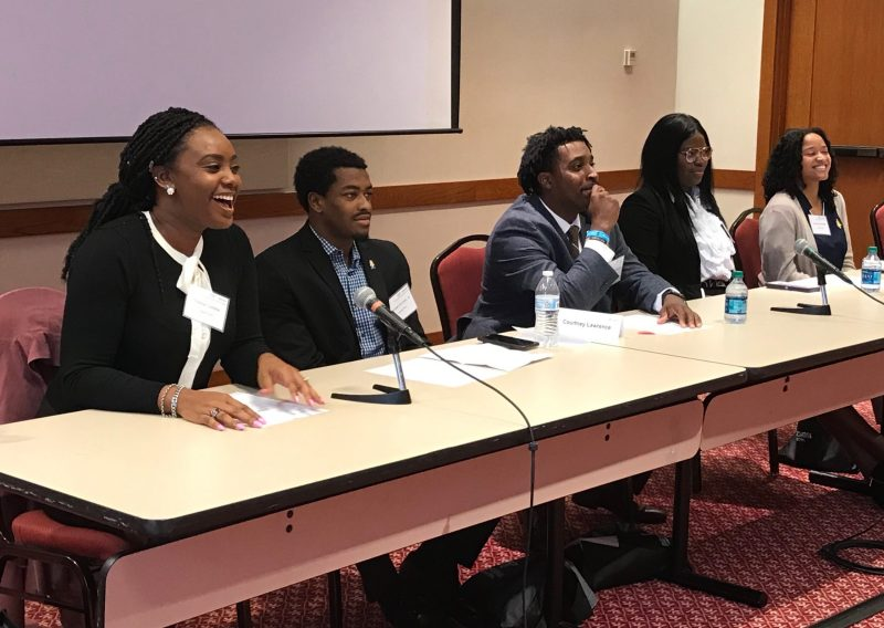 Graduate student Trichia Cadette laughs as she responds to a student during a panel discussion. Also pictured: Wendell Grinton, Jr.; Courtney Lawrence; Janay Frazier; and Lauren Blackwell