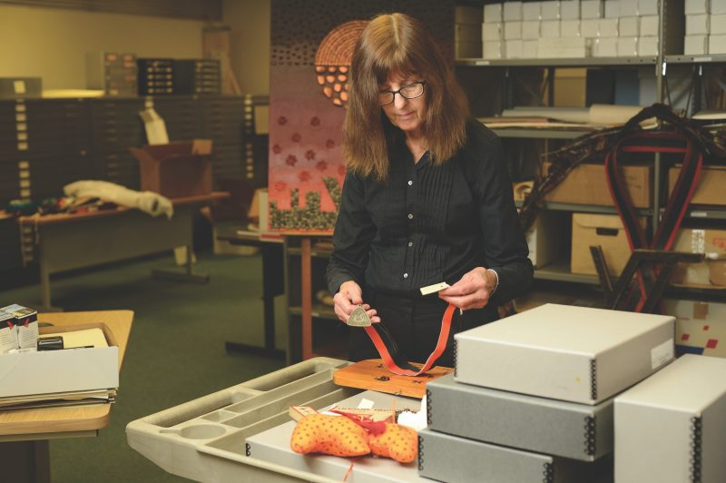 Tamara Kennelly is shown working in the University Libraries' Special Collections and University Archives.
