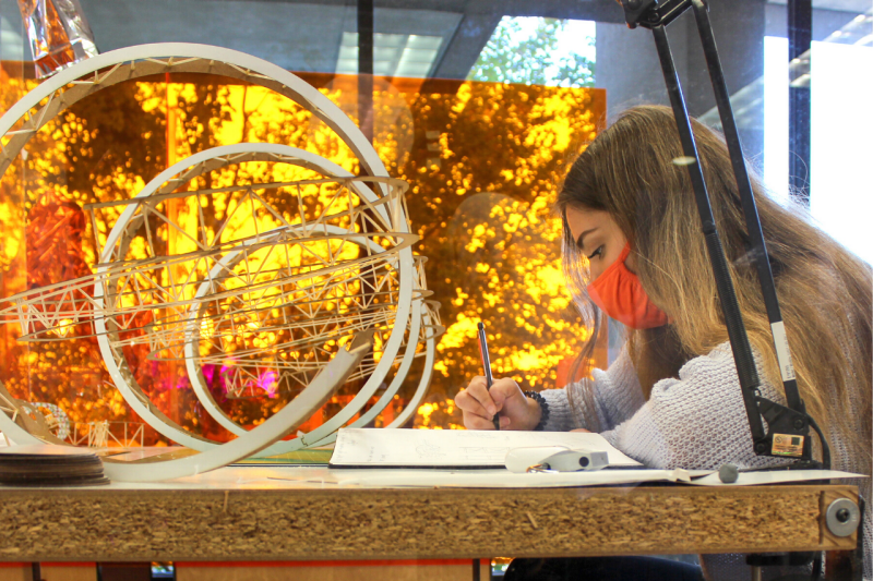First-year architecture student Carley Parsons works at her studio desk in Cowgill Hall