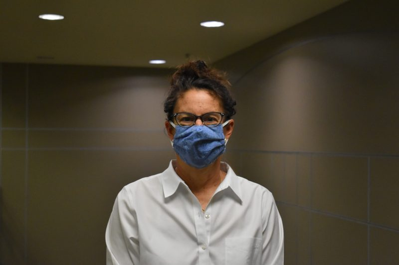 Patricia Hammer, photographed wearing a bright blue face mask recently at North End Center.