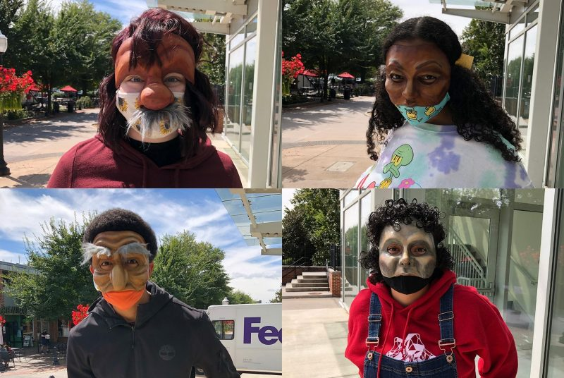 Four university students wearing commedia del arte style masks, each standing outside.