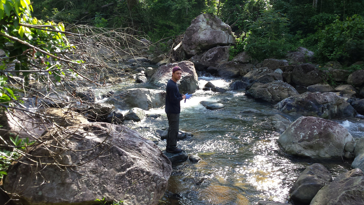 Civil engineering doctoral student Benjamin Davis takes water samples from the Rio Marin River in Patillas, Puerto Rico in early 2018.
