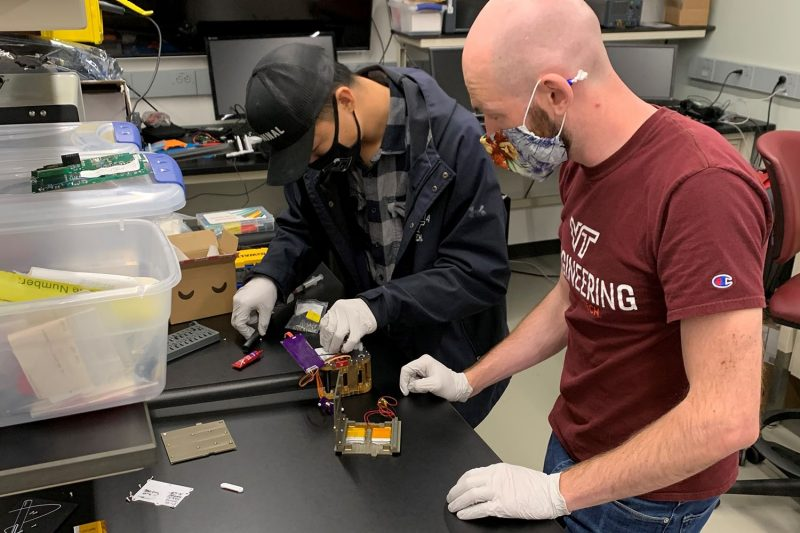 Students at Space@VT prepare their satellite for preflight testing.