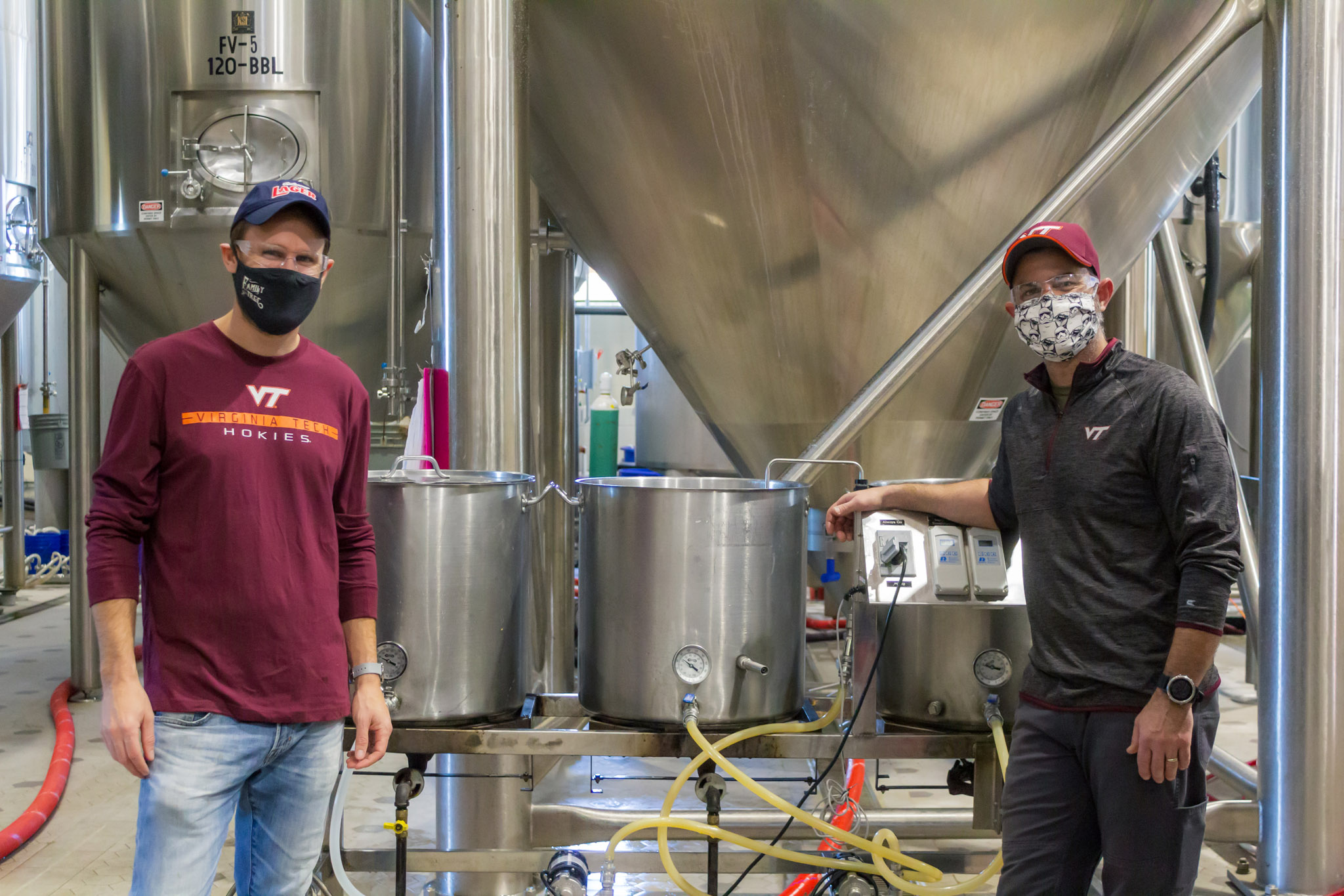 Hardywood Brewmaster Patrick  Murtaugh (left) and Vice President of Production and Head Brewer Brian Nelson, mechanical engineering '01, brewing a pilot batch of Fightin' Hokies Lager. Photo courtesy of Hardywood Park Craft Brewery.