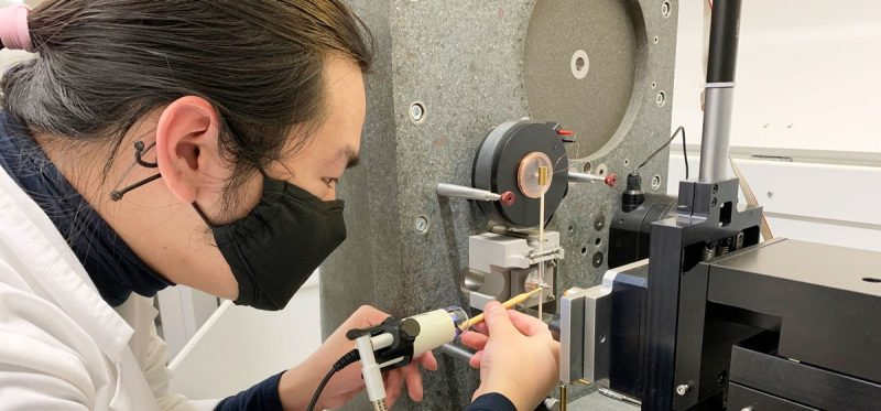 ME graduate student Zhifei Deng performing nanomechanical testing on a nanoindenter.