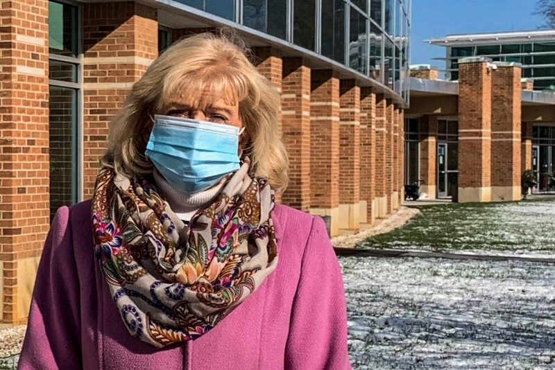 Director Penny McCallum stands masked in front of the Southwest Center.
