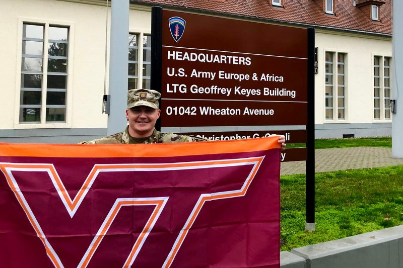 U.S. Army Maj. Nick Nelson holds a Virginia Tech flag.
