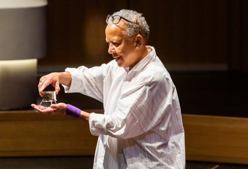 "During the Nikki Giovanni Celebration of Poetry in 2019, Nikki Giovanni showed the audience ""The Steger,"" a piece of art that local jeweler Faith Capone handcrafts each year for the winner of Virginia Tech's annual poetry prize. The sterling-silver artwork has an inset magnifying glass to symbolize the power of poetry to enlarge our understanding of the world."