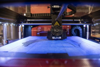 A Raise3D printer builds layers of a face shield headband. Photo: Spencer Roberts for Virginia Tech