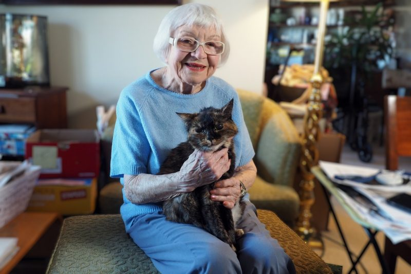 Evelyn Blake enjoys a moment in her home with her feline companion, Callie.