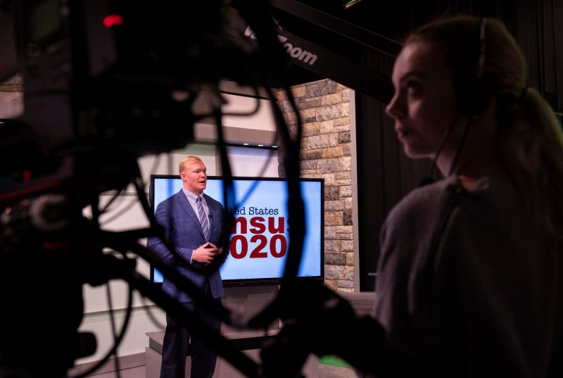 Andrew Webb, a senior majoring in multimedia journalism, does a news segment in the Department of Communication's broadcast studio in the Moss Arts Center.