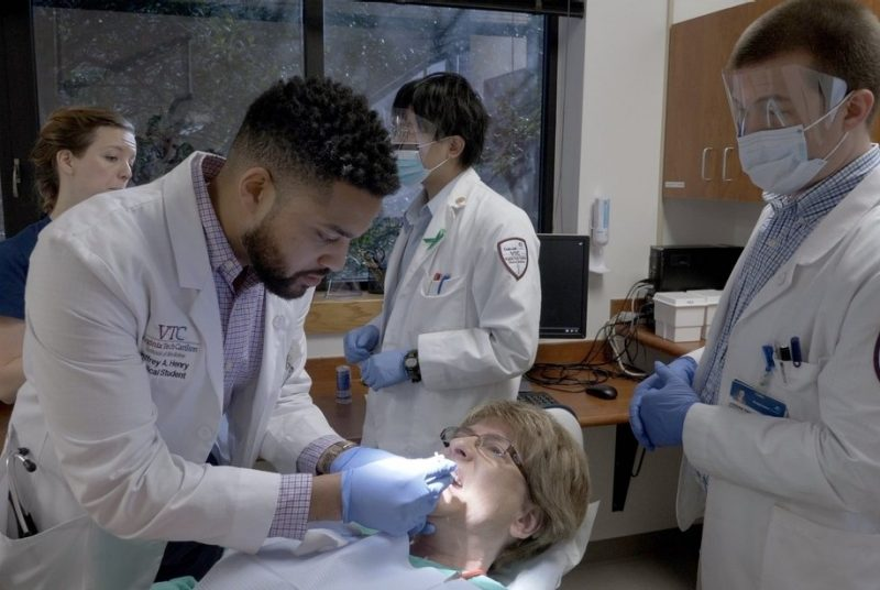 Students perform oral health exam
