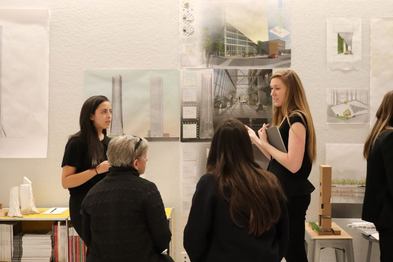 Chicago Studio students Toufa Kinani (left) and Chloe Fanelty present their design during the final critique of the fall 2018 semester.