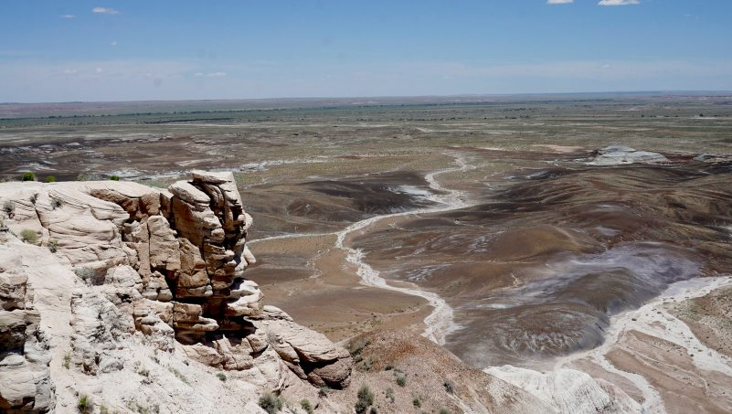 According to paleontologists, Petrified Forest National Park is a great place to find fossils from the beginning of the Age of Dinosaurs, circa 220 million years ago. In this area, rocks that were once deposited by rivers and lakes are exposed and within them, one can find a rich diversity of life. In this image, taken from a high angle on a bright day, the park can be seen stretching for miles. Photo courtesy of Brenen Wynd.