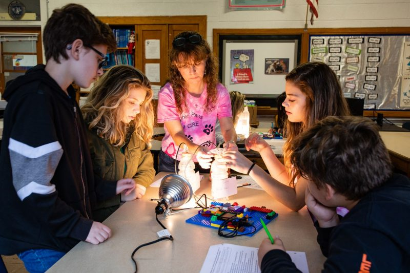 middle school students working on a hands-on engineering activity