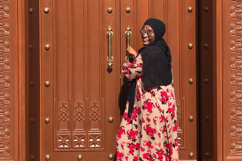 Sidiratu Bangura pulling open an ornate door