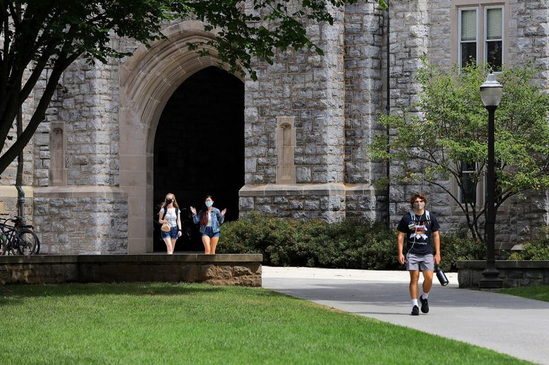 Students walk on campus during the first day of classes for the fall 2020 semester.