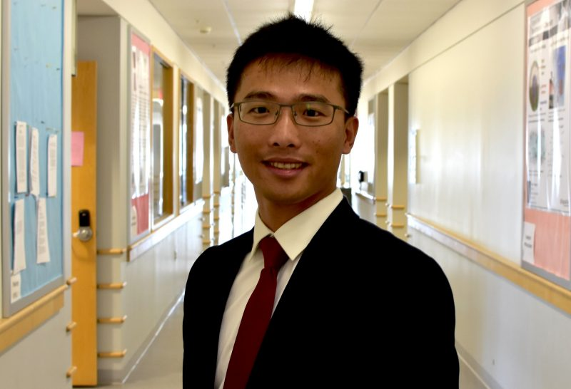 In this photo from 2016, Assistant Professor Feng Lin poses wearing a suit and tie at Hahn Hall North.