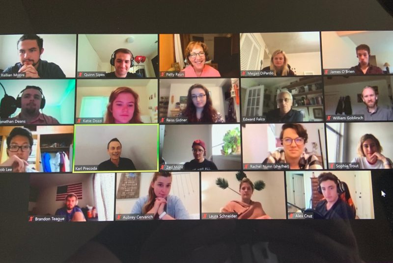 Computer screen filled with pictures of people on a Zoom call