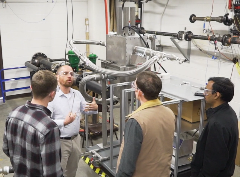 In a photo from 2019, the collaboration between Virginia Tech and MOVA led to testing of the design in the Advanced Propulsion and Power Laboratory in the College of Engineering. After testing, the Virginia Tech team believed that a successful proof-of-concept was achieved, confirming that the technology can capture gaseous and particulate matter pollutants.