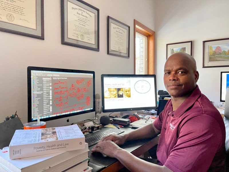 Pamplin faculty member Quinton Nottingham, shown in his office at home, will guide a team of Virginia Tech students in data collection and analysis for the program.