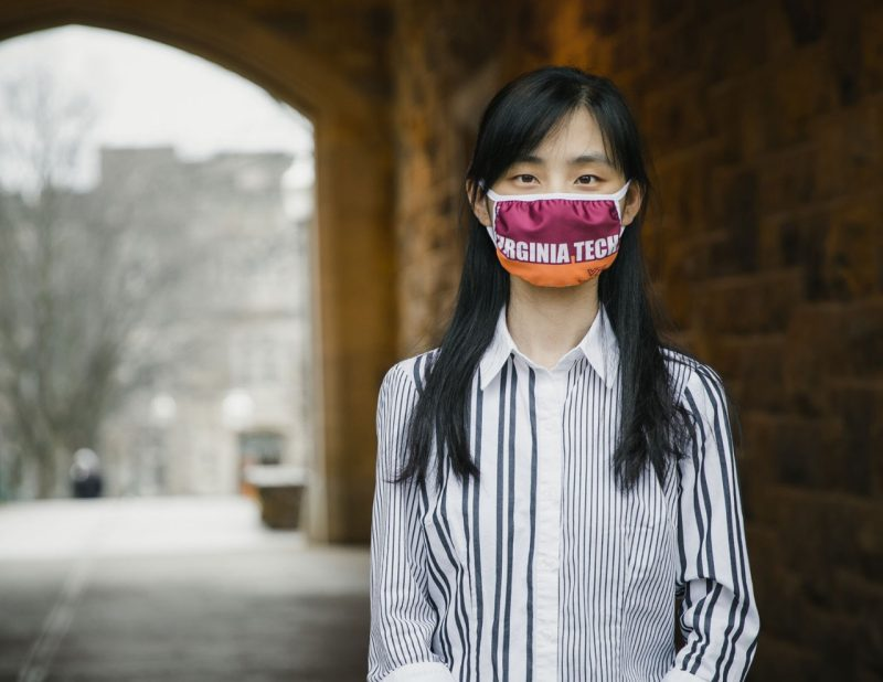 Portrait of Lisha Yuan, doctoral Engineering Mechanics student in BEAM, wearing a Virginia Tech mask