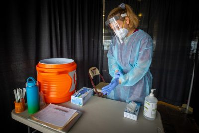 Emily Schofield prepares for one of many COVID-19 swab tests at Lane Stadium. Photo by  Ray Meese.