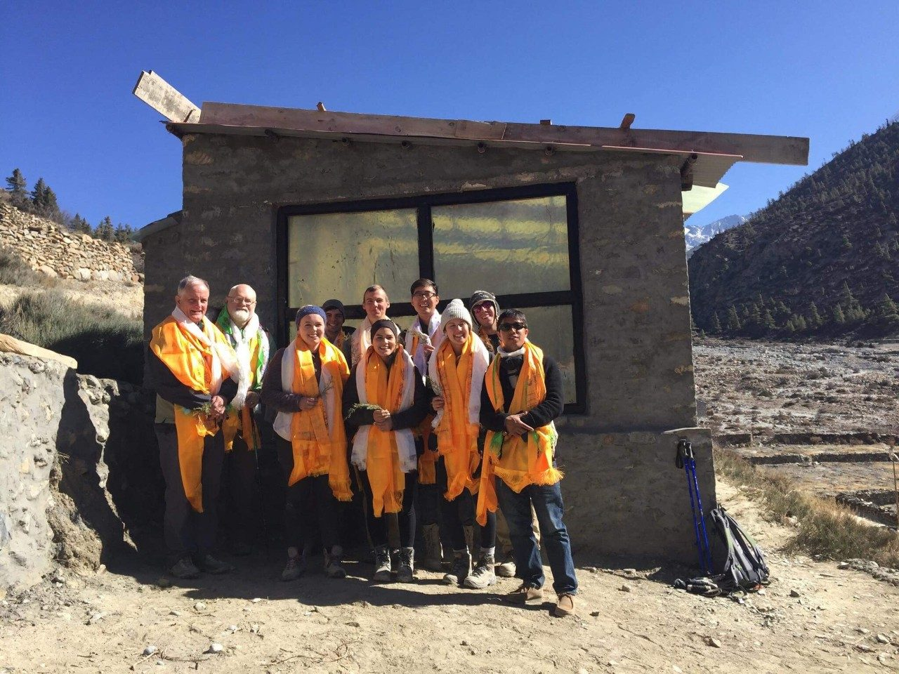 Virginia Tech's Service Without Borders team in front of a warming hut during the Winter 2017-18 trip to Nepal. Back row, from left: Tom Hammet, Professor of Sustainable Biomaterials; Brian Benham, Professor Biological Systems Engineering; Alfonso Marino; Mark Shepheard; Julian Park; Evan Charnoff. Front Row, from left: Sylvia Connor;  Sara Herndandez; Lauren Holt; and Tsewang Gyurme, in country contact/local guide. Photo submitted by Mark Shepheard.
