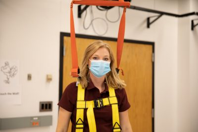 Caitlin Bowman is strapped into the walking harness used to analyze her movement.