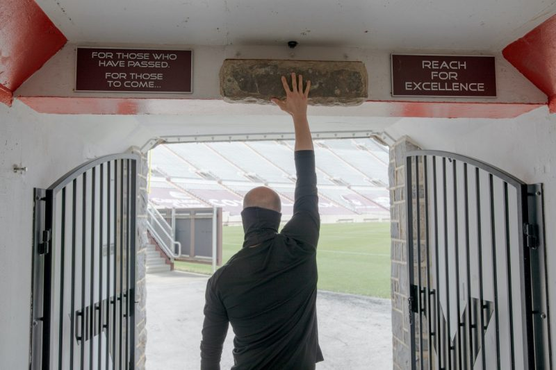 As Marc Lewis touches the Hokie Stone in the Lane Stadium tunnel, he remembers everything he went through to get to this point.