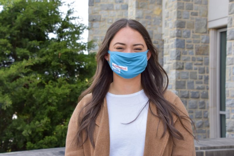 Christine Faunce is the Virginia Tech College of Science's Outstanding Senior for 2021. Here she stands outside the Life Sciences Building 1, wearing a mask, where she has carried out benchwork research. Photo by Melissa Vergara.