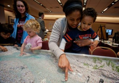 Families learn at a simulated river during the academic showcase, held at the Inn at Virginia Tech and Skelton Conference Center.