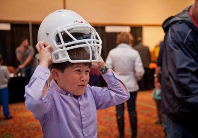 Children and families learn about research being done at the Virginia Tech-Wake Forest University School of Biomedical Engineering and Sciences that tests helmets and rates their ability to reduce the risk of concussions.