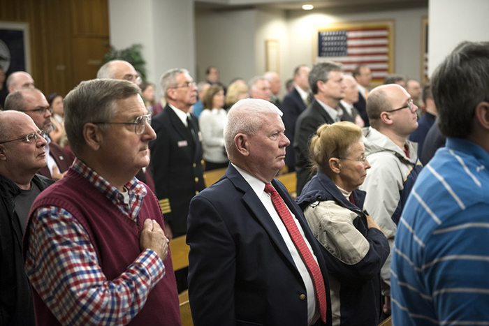 Attendees listen during the remembrance ceremony in War Memorial Chapel.